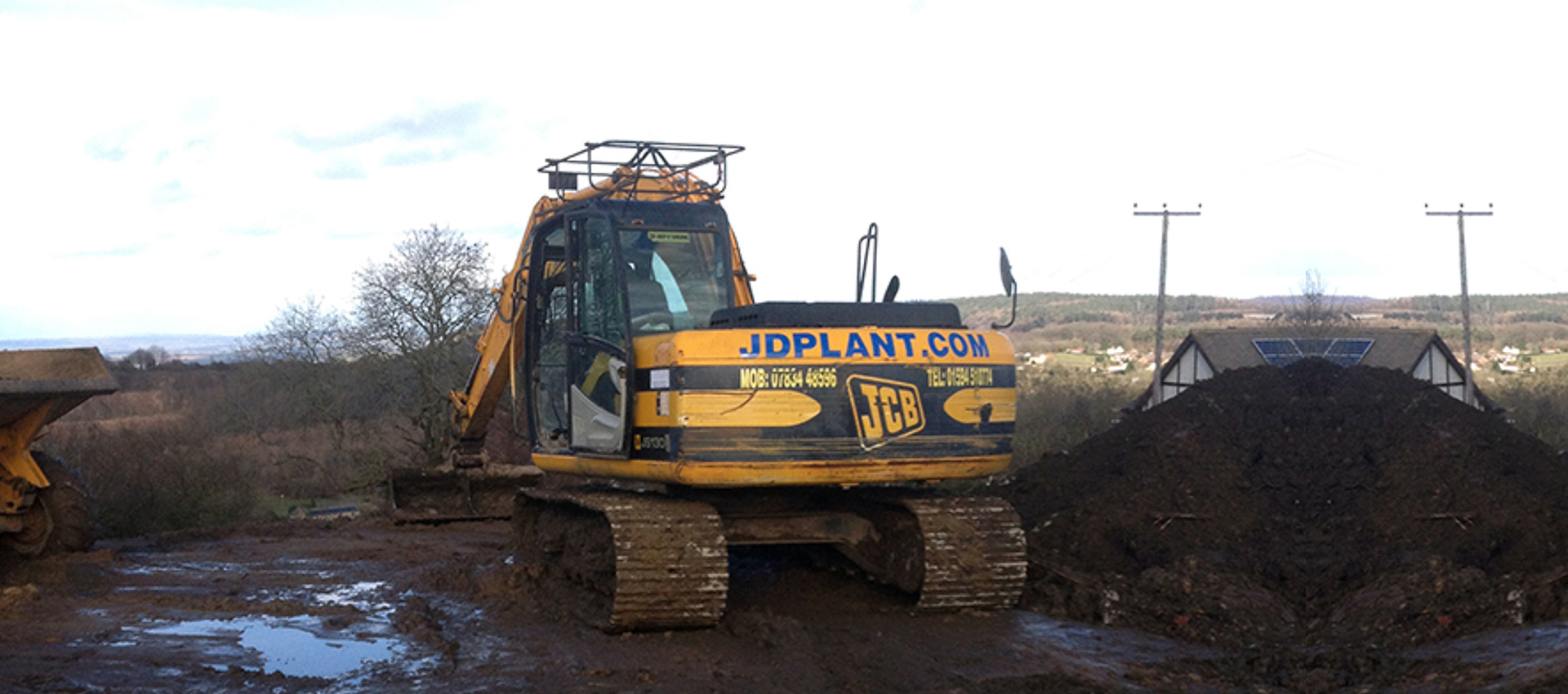 JD Plant Groundworks excavator from behind